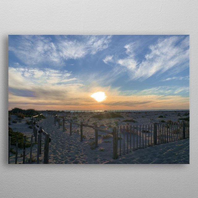 It is already hot, the sun continues to rise. The sky is amazing, the light is superb. Everything is quiet on this beach at this early hour. metal poster