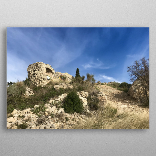 Somewhere in the south of France, on the top of a large hill, magnificent ruins of an old castle under a great blue cloudy sky. metal poster