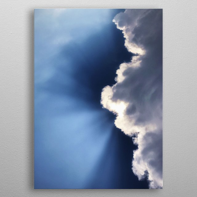 Above the sea, just before the storm, we admired this beautiful light, the sun playing with the clouds and a very deep blue sky. metal poster