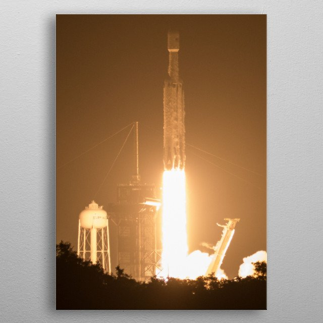 The Falcon Heavy is a partially reusable heavy-lift launch vehicle designed and manufactured by SpaceX. metal poster