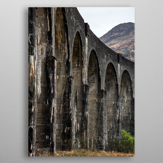 Glenfinnan viaduct, seen in the Harry Potter films when the Jacobite Steam Train was featured as the fictional Hogwarts Express. metal poster