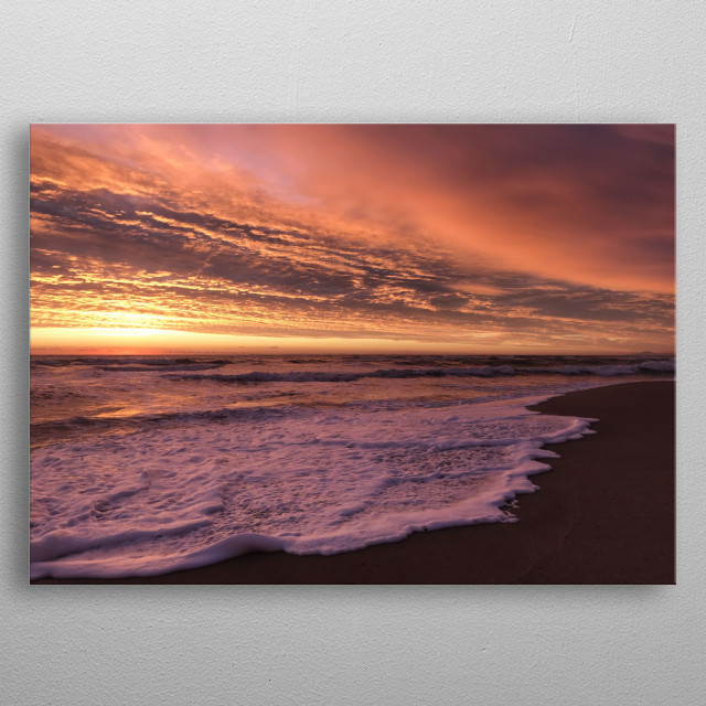 Stunning dawn light with these shades of color, the clouds above the sea announce a storm, the waves are rising. A great moment we captured. metal poster