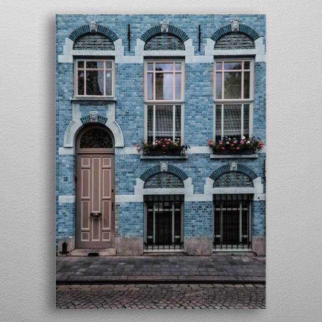 Facade of a prettu blue old brick house metal poster