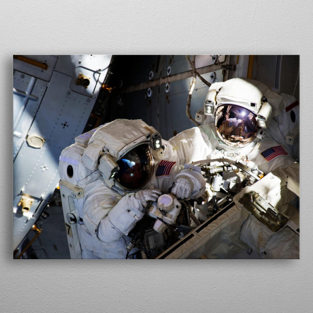 S134-E-008973 (25 May 2011) --- With components of the International Space Station in the view, NASA astronauts Andrew Feustel (right) and M metal poster