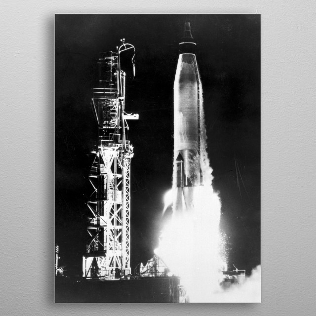 AN ATLAS LAUNCH VEHICLE CARRYING THE BIG JOE CAPSULE LEAVES ITS LAUNCH PAD ON A 2,000 MILE BALLISTIC FLIGHT TO ALTITUDES OF 100 MILES. THE B metal poster