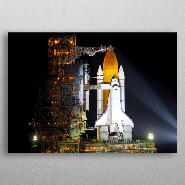 CAPE CANAVERAL, Fla. -- Space shuttle Atlantis, attached to its bright-orange external fuel tank and twin solid rocket boosters, is  bathed  metal poster
