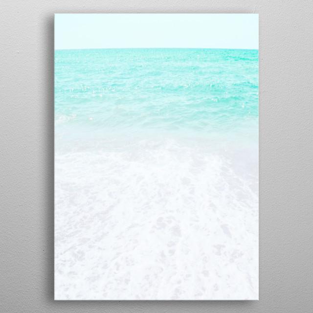 A capture of sea foam on a beautiful beach. metal poster