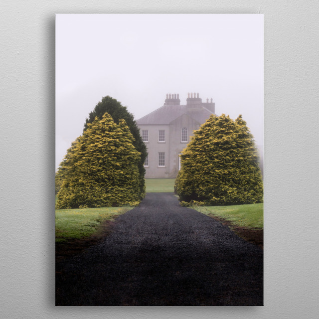 Pretty english house surrounded by bushes on a very cold foggy morning. metal poster
