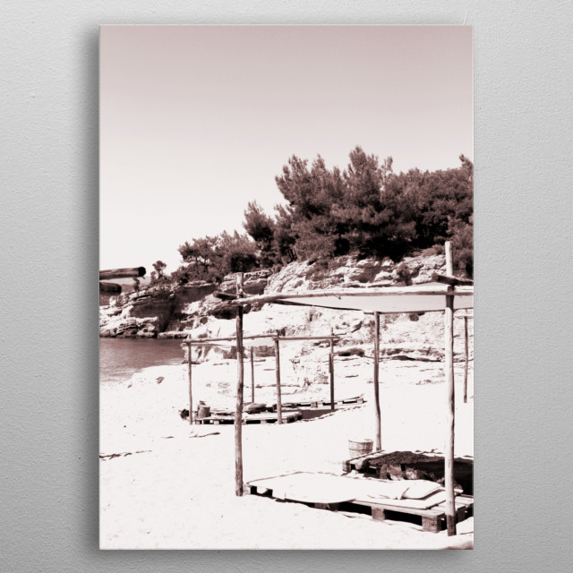 Monochrome capture of a beautiful beach with sunshades. metal poster