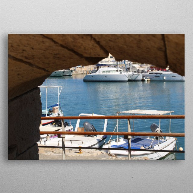 This photo was taken thru the opening in the stone wall where I had the view on a port with fishing boats and yachts.  metal poster