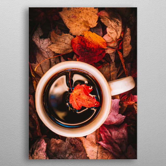 Autumns colorful leaves surround a cup hot rich coffee. A single leaf falls into the coffee. Photography by Bob Orsillo metal poster