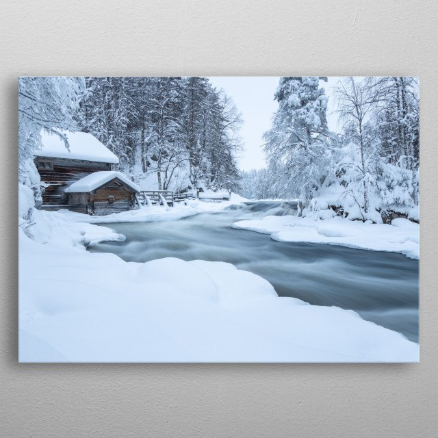 A long exposure image of a stream flowing past an old wooden mill metal poster