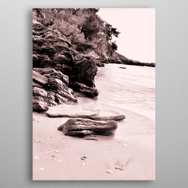 Monochrome capture of a beautiful rocky beach. metal poster