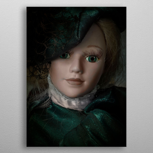 Closeup of a doll waring green victorian outfit metal poster