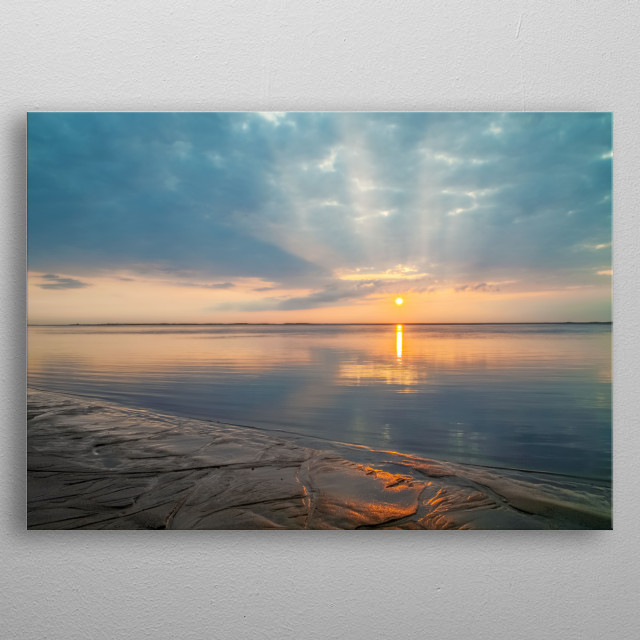 Photographed on Cape Cod, a golden sun rises off the shore of Chatham Lighthouse Beach. The sun glows orange on the damp sand.  metal poster