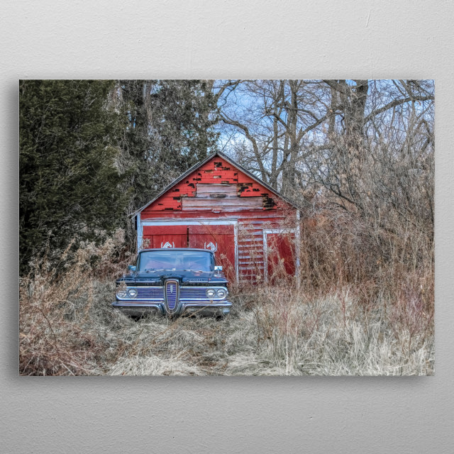 I discovered this red barn and a blue 1950s vintage car on a drive. Do you see the horses painted on the barn doors? metal poster