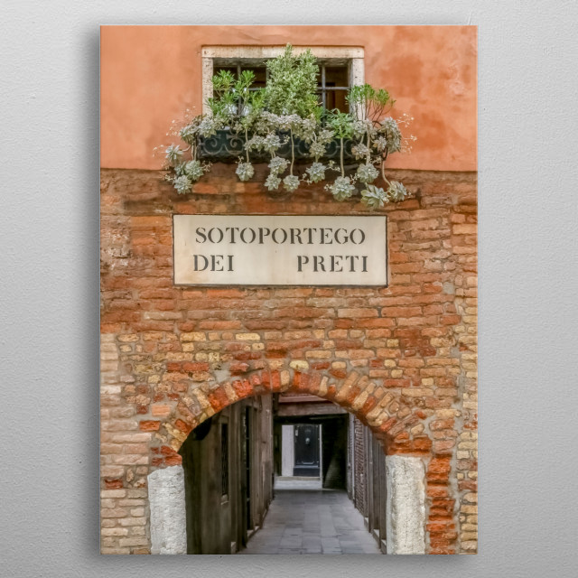 This window box is overflowing with green succulents. It is in Venice on a terra cotta - colored building, Sotoportego dei Preti.  metal poster