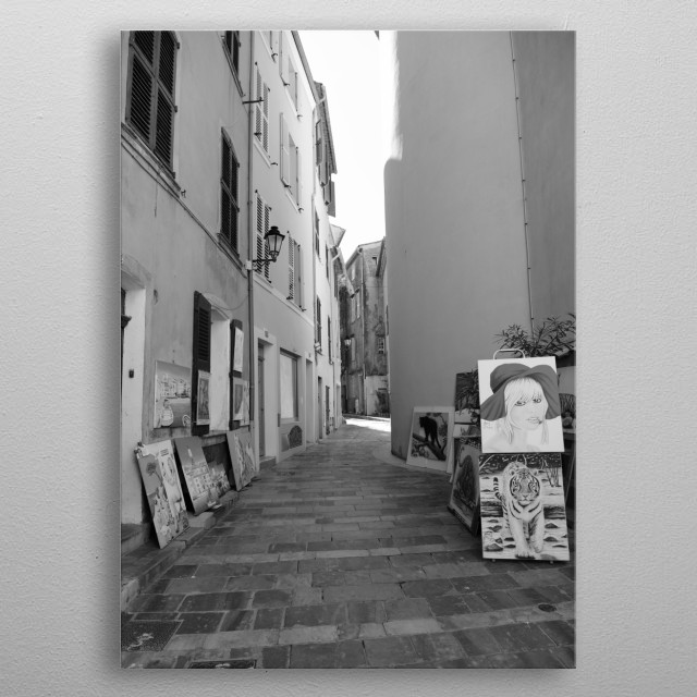 Artist in Saint-Tropez (Small Street) near the church by photographer Tom V. metal poster