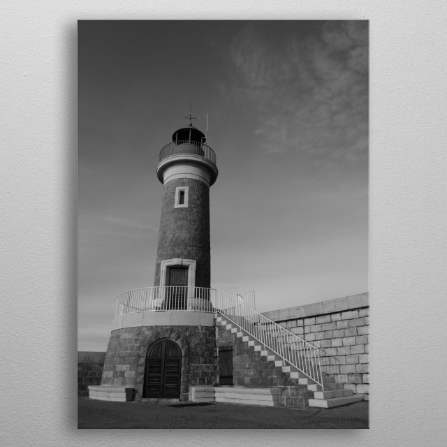The Lighthouse of one of the most famous harbors in Europe, Saint-Tropez by photographer Tom Vandenhende.   metal poster