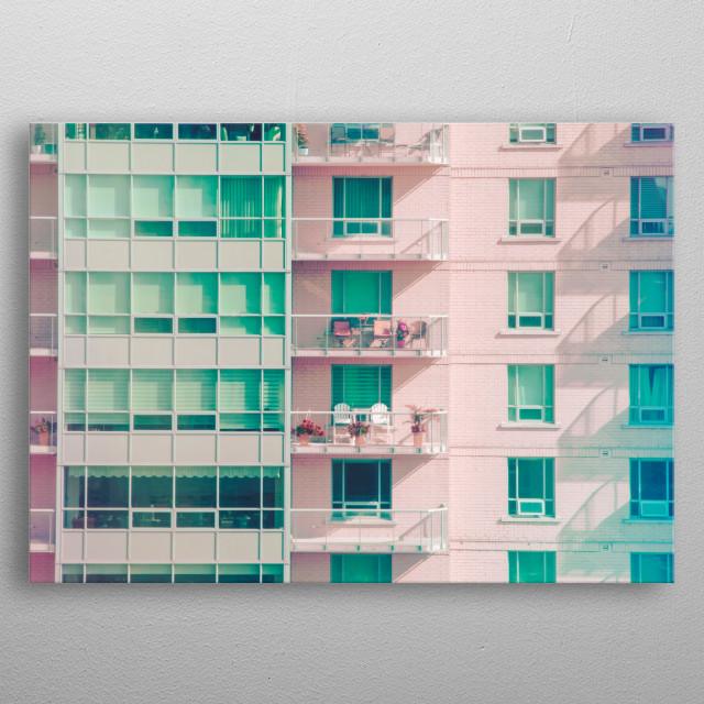 Pastel pink and mint green apartment building exudes summer vibes. Flowers and chairs line the balconies. The sun casts shadows of railings. metal poster