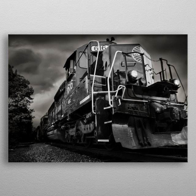Black and white PAN AM diesel train engine busts out of the frame as it rolls down the tracks - photography by Bob Orsillo metal poster