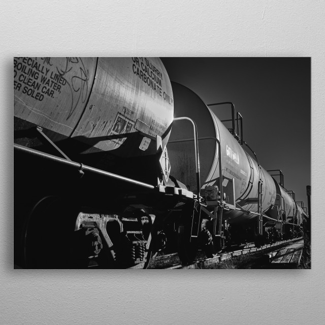 Long line train of Tank Cars heads into the industry section of the city. Black and white photography by Bob Orsillo metal poster