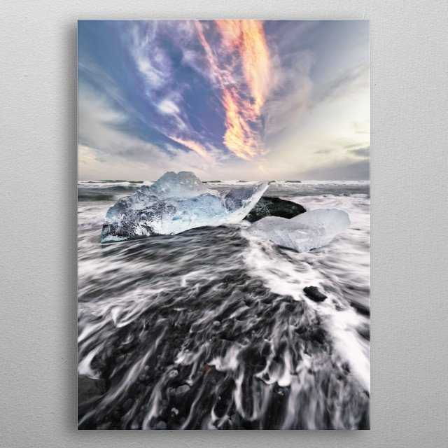 Ice blocks on a beach with surf, the dynamics of a wave can be seen, above it striking reddish clouds of evening light, Iceland, Jökulsarlon metal poster