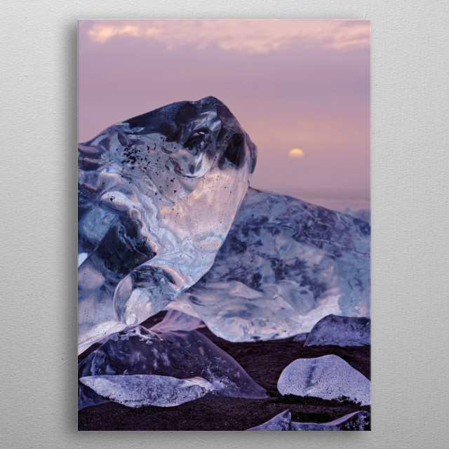 Striking ice formations are staged by clouds lit by a cloud cover in red and yellow shades, setting sun, Iceland, glacier lagoon Jokulsarlon metal poster