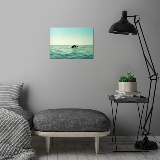 Whale wall art is showcased in interior