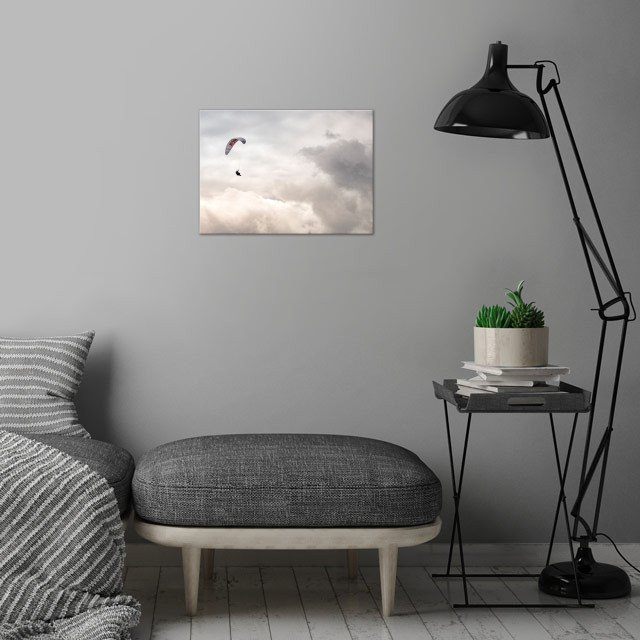 Paraglider in the clouds wall art is showcased in interior